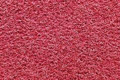 Rött rubber mattt Fotografering för Bildbyråer