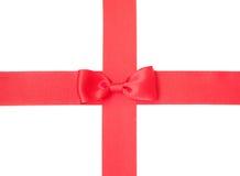 Rött satängband med bowen Arkivfoto