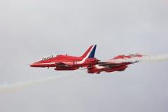 rött synchro för pilpar Arkivbilder