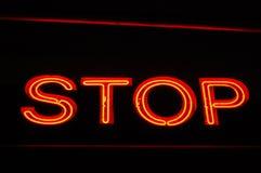 rött teckenstopp för neon Arkivfoto