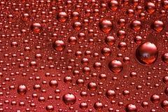 rött vatten för bakgrundsdroppe Royaltyfria Foton
