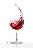 Rött vinexponeringsglas på en vit bakgrund Royaltyfri Bild