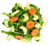 Rúcula, cenoura, azeitona e aipo isolados no fundo branco Imagens de Stock Royalty Free