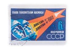 RÚSSIA - CERCA DE 1962: Um selo impresso em URSS, dedicada ao fligh imagens de stock