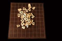 Rückenbrett und Stücke von Shogi stockbilder