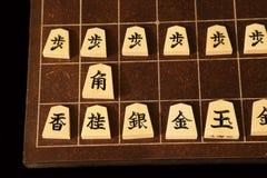 Rückenbrett und Stücke von Shogi stockfoto