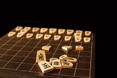 Rückenbrett und Stücke von Shogi stockfotografie