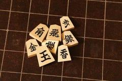Rückenbrett und Stücke von Shogi lizenzfreie stockbilder