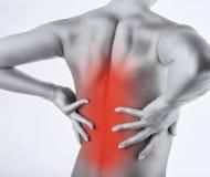Rückenschmerzen Stockfotos
