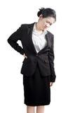 Rückenschmerzen oder schmerzliche Taille in einer Frau lokalisiert auf weißem Hintergrund Beschneidungspfad auf weißem Hintergrun Lizenzfreies Stockfoto
