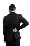 Rückenschmerzen oder schmerzliche Taille in einer Frau lokalisiert auf weißem Hintergrund Beschneidungspfad auf weißem Hintergrun Lizenzfreie Stockfotos