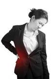 Rückenschmerzen oder schmerzliche Taille in einer Frau lokalisiert auf weißem Hintergrund Beschneidungspfad auf weißem Hintergrun Lizenzfreie Stockbilder