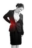 Rückenschmerzen oder schmerzliche Taille in einer Frau lokalisiert auf weißem Hintergrund Beschneidungspfad auf weißem Hintergrun Stockfotografie
