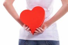 Rückseite des Herzens hinten halten Stockbild
