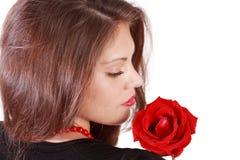 Rückseite und Profil der jungen Frau mit Rotrose Lizenzfreies Stockfoto