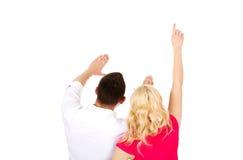 Rückseitige Ansicht der jungen Paare lizenzfreie stockbilder