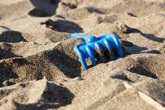 Rührstange auf Sand Stockfotos