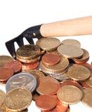 Rührstangen und Stapel der Münzen. Stockbild