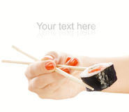 ręce gospodarstwa mak sushi Obraz Royalty Free