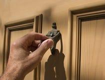 ręce knocker drzwi Fotografia Stock