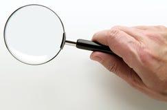 ręce powiększać szklany Obraz Stock