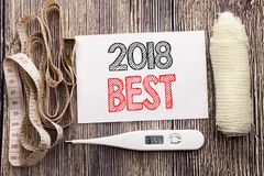 Ręcznie pisany tekst pokazuje 2018 sprawności fizycznych zdrowie pojęcia Najlepszy Biznesowego writing dla wybór kleistej notatki Fotografia Stock