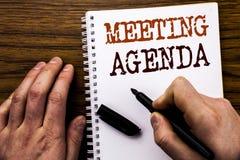Ręcznie pisany teksta seansu słowa spotkania agenda Biznesowy pojęcie dla Biznesowego rozkładu planu Pisać na pastylka laptopie,  Zdjęcie Stock