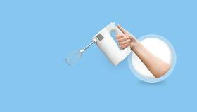 Ręczny elektryczny melanżer w ręce Fotografia Stock