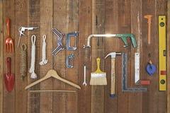 Ręk equipments i narzędzia wieszają na drewno desce Obraz Royalty Free