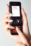 ręka żeński telefon Zdjęcia Stock