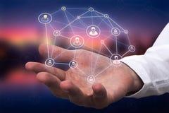 Ręka biznesmena mienia technologii interfejs z interfejsu kontaktu ikoną fotografia royalty free