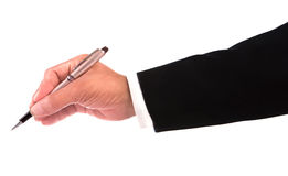 Ręka biznesowego mężczyzna mienia luksusowy pióro i writing Fotografia Stock