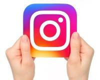 Ręka chwytów Instagram ikona na białym tle fotografia stock