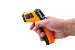 Ręka chwyta IR termometr Fotografia Stock