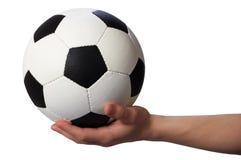 Ręka chwyta piłki nożnej piłka fotografia stock