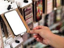 Ręka chwyta smartphone biała skrzynka Zdjęcia Royalty Free