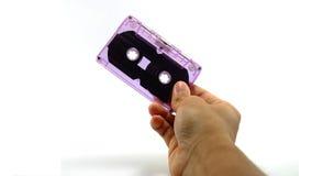 Ręka chwyta taśmy kaseta Fotografia Royalty Free