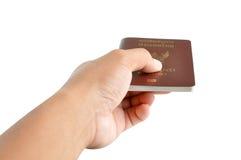 Ręka daje paszportowi Zdjęcia Stock