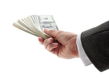 Ręka daje pieniądze Zdjęcia Stock