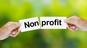 Ręka drzeje słowo Nonprofit dla zysku Obrazy Royalty Free