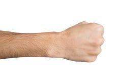 Ręka gest, mężczyzna zaciskał pięść, przygotowywającą uderzać pięścią odosobnionego na bielu Fotografia Royalty Free