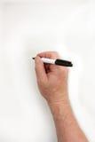 Ręka i markier Mężczyzna ` s ręka pisze markiera Zdjęcia Stock