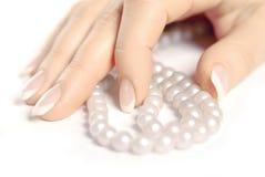 Ręka i perły Obraz Royalty Free