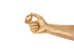 ręka jajeczny złocisty mężczyzna s obraz stock