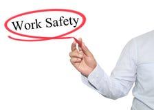 Ręka mężczyzna pisze tekst pracy bezpieczeństwie z czarnym kolorem odizolowywającym Obraz Royalty Free
