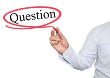 Ręka mężczyzna pisze teksta pytaniu z czarnym kolorem odizolowywającym na whi Obrazy Stock