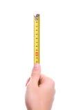 ręka odizolowywająca miara pomiarowej taśmy Zdjęcie Stock