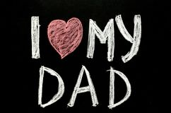 Ręka pisać teksta ` kocham mój tata ` na chalkboard Obrazy Stock