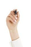 Ręka pisze coś z markierem na przejrzystym szkle Obrazy Stock