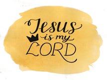 Ręka pisze list Jezus jest mój królewiątkiem na akwareli tle fotografia royalty free